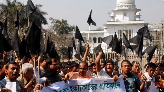 Bangladeshi Hindus wave black flags as they march through a street to protest against alleged attacks by Jamaat-e-Islami activists in Dhaka, Bangladesh, March 2, 2013.