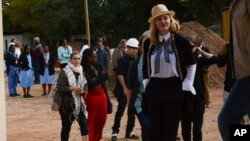 US performer Madonna visits the pediatric surgery and Malawi's first ever intensive care unit at Queen Elizabeth Central Hospital in the southern city of Blantyre, July 10, 2016.
