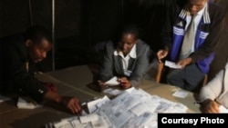FILE: Polling officers counting ballots in a previous Zimbabwe election.