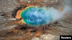 Yellowstone National Park's Grand Prismatic hot springs are among the park's hydrothermal features. They were created by a supervolcano – the largest type of volcano on Earth -- where Yellowstone now sits.