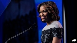 FILE - U.S. first lady Michelle Obama speaks in Washington D.C., March 14, 2014.