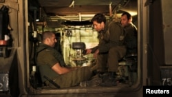 Israeli soldiers in an Armoured Personnel Carrier at a staging area outside the northern Gaza Strip, Nov. 21, 2012.