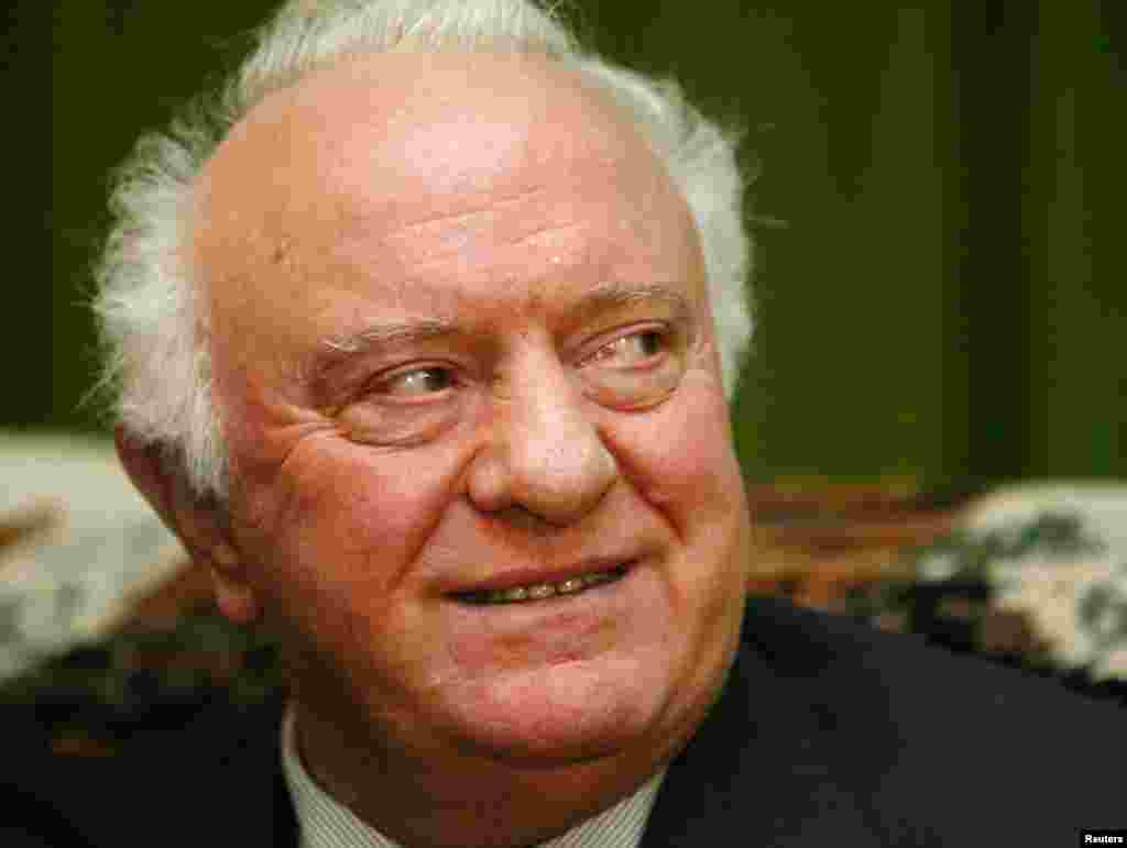 Former Georgian President Eduard Shevardnadze smiles during an interview with Reuters in his residence in Tbilisi, Nov. 24, 2003.