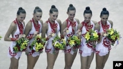 The Russian women team pose with their gold medals after the Group All Around final at the 30th rhythmic gymnastics world championships in Moscow, Russia, 26 Sept 2010