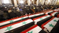 کشته شدگان بمب گذاری های دوگانه در سوریه بخاک سپرده می شوند