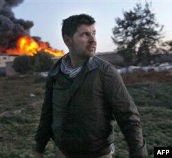 Kris Xondros, fotorgraf, jurnalist