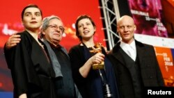 "Director, screenwriter, editor and producer Adina Pintilie and cast members pose with the Golden Bear award for best film, ""Touch Me Not,"" at the news conference after the awards ceremony at the 68th Berlinale International Film Festival in Berlin, Germany, Feb. 24, 2018."