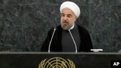 File - Iranian President Hassan Rouhani addresses a high-level meeting on Nuclear Disarmament during the 68th United Nations General Assembly, Sept. 26, 2013.