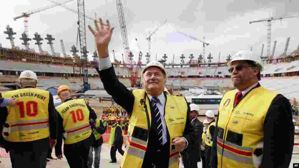 FIFA president Sepp Blatter, left, waves to people as a World Cup organizer Danny Jordaan, right, looks on during a visit to one of the 2010 World Cup football stadiums situated in Cape Town, Monday, Sep. 15, 2008. FIFA president Sepp Blatter claims