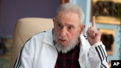 FILE - Cuba's Fidel Castro speaks with Russia's President Vladimir Putin in Havana.