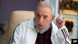FILE - Cuba's Fidel Castro speaks with Russia's President Vladimir Putin (not seen) in Havana, July 14, 2014.