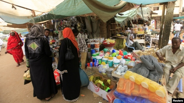 Women wait to shop for Ramadan at a central food market in Khartoum, Sudan, July 18, 2012.