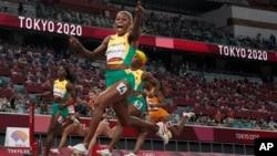 Elaine Thompson-Herah, of Jamaica, wins the women's 100-meter final at the 2020 Summer Olympics, Saturday, July 31, 2021, in Tokyo. (AP Photo/Petr David Josek)