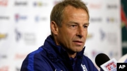 """U.S. men's national soccer team coach Jurgen Klinsmann, who has been """"relieved of his duties"""" as coach and technical director, takes part in a news conference in St. Louis, Nov. 12, 2015."""