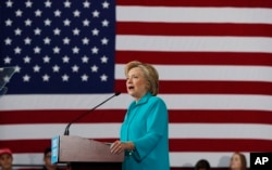 FILE - In this Aug. 25, 2016 file photo, Democratic presidential candidate Hillary Clinton speaks at a campaign in Reno, Nev. Young Hispanics, Asian-Americans and African-Americans are much more likely to trust Hillary Clinton than Donald Trump to deal with immigrants living in the United States illegally.