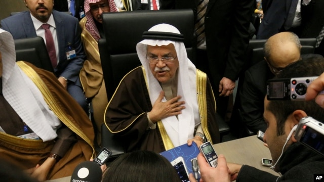 FILE - Saudi Arabia Minister of Petroleum and Mineral Resources Ali Ibrahim Naimi speaks to journalists before a meeting of the Organization of the Petroleum Exporting Countries, OPEC, at their headquarters in Vienna, Austria, Dec. 4, 2015.