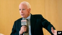 Sen. John McCain speaks during a forum with veterans in Phoenix, Arizona, May 9, 2014.