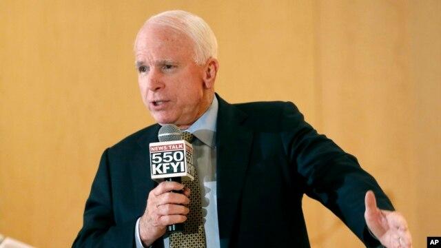 Sen. John McCain speaks during a forum with veterans in Phoenix, Arizona, May 9, 2014.