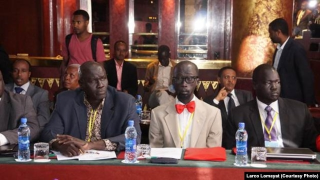 Opposition negotiators Hussein Mar Nyuot (L), and Mabior de Garang (C) at peace talks for South Sudan in Addis Ababa.