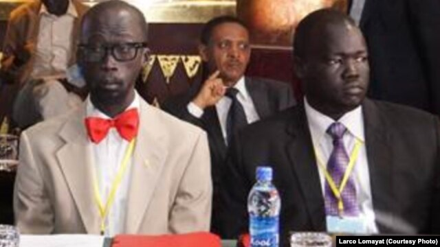 """Opposition negotiator Hussein Mar Nyuot (R), shown here with Mabior de Garang (L) at the first round of peace talks for South Sudan in Addis Ababa in January, says the warring sides have agreed to a """"month of tranquility"""" starting May 7."""
