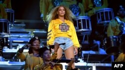 FILE - Beyonce Knowles performs onstage during the Coachella music festival in Indio, California, April 14, 2018.