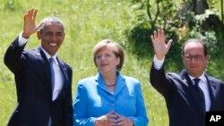 Barack Obama, Angela Merkel et François Hollande au somment du G7 à Schloss Elmau près de Garmisch-Partenkirchen, en Allemagne, le 7 juin 2015.(AP Photo/Markus Schreiber)
