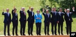 German Chancellor Angela Merkel (C) poses with G7 leaders during a group photo at the G7 summit at Schloss Elmau near Garmisch-Partenkirchen, southern Germany, June 7, 2015.
