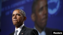 U.S. President Barack Obama pauses while speaking about gun violence during an address to the United States Conference of Mayors in San Francisco, June 19, 2015.