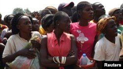 Displaced refugee women, escaping the violence, wait to receive humanitarian aid at the airport outside the capital Bangui, Central African Republic, Jan. 7, 2014.