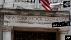This 2014 file photo shows the Wall Street entrance of the New York Stock Exchange.