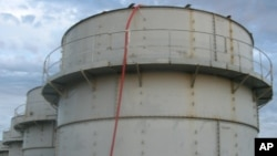 Tokyo Electric Power Co. shows the storage tank which workers detected the water dripping from the top, at the Fukushima Dai-ichi nuclear plant at Okuma town in Fukushima prefecture, northeastern Japan Thursday, Oct. 3, 2013.