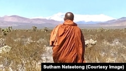 Buddhist monk Sutham Nateetong is walking across the USA to promote peace