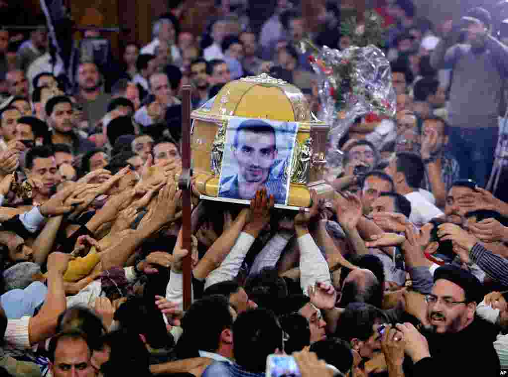 Egyptian Christians carry the coffin of Morqos Kamal, at the Saint Mark Coptic cathedral in Cairo, Egypt, April 7, 2013.