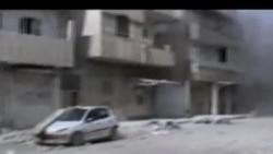 2012-02-14 美國之音視頻新聞: 敘利亞人權活動者說霍姆斯遭炮火猛烈襲擊