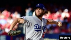 FILE - Los Angeles Dodgers starting pitcher Clayton Kershaw throws a pitch against the St. Louis Cardinals.