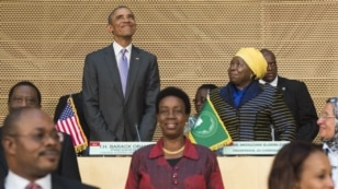 US President Barack Obama (L), alongside African Union Chairperson Nkosazana Dlamini Zuma (R), arrives to speak about security and economic issues and US-Africa relations in Africa at the African Union Headquarters in Addis Ababa, on July 28, 2015.
