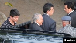 Brazil's former President Michel Temer arrives at the Battalion of the Military Police after being transfered from the Federal Police, in Sao Paulo, Brazil, May 13, 2019.