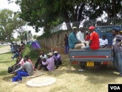 The camping former GMB workers claim that they have been locked out of the GMB premises. (Photo: Patricia Mudadigwa)