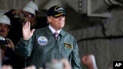 President Donald Trump aboard a Naval ship on Thursday.