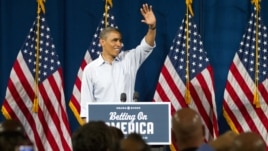 President Barack Obama waves at Dobbins Elementary School in Poland, Ohio during his Betting On America campaign tour, July 6, 2012.