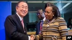 United Nations Secretary General Ban Ki-moon, left, greets Central African Republic President Catherine Samba-Panza as he arrives for a meeting on Central African Republic prior to the EU Africa summit at the EU Council building in Brussels, April 2, 2014