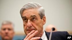 """Prokirè espesyal Robert Mueller ki nan tèt ankèt sou """"entèferans Larisi"""" nan eleksyon novanm 2016 la ak yon posib demach Prezidan Trump pou l bloke travay lajistis."""