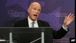 """California Gov. JerryBrown, speaking in this Sept. 4, 2014 during a gubernatorial debate in Sacramento, has signed a bill that makes California the first in the nation to define when """"yes means yes."""""""