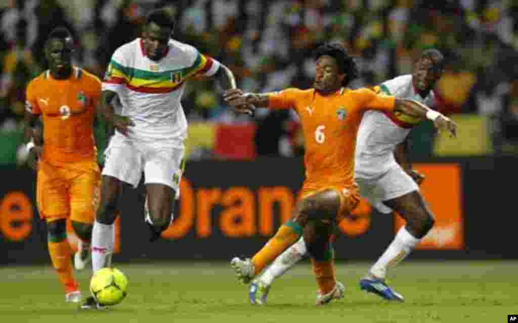 Mali's Cheick Diabate (9) plays against Ivory Coast's Jean-Jacques Gosso (6) during their African Nations Cup semi-final soccer match at the Stade De L'Amitie Stadium in Gabon's capital Libreville February 8, 2012.