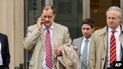FILE - Former Massey Energy CEO Don Blankenship, left, makes his way out of the Robert C. Byrd U.S. Courthouse during a break in deliberations, Dec. 1, 2015, Charleston, West Virginia.