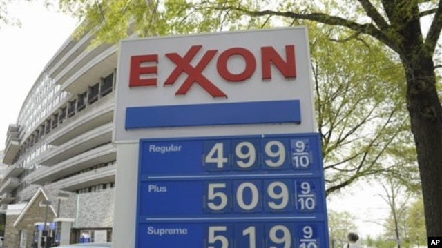 Gas prices above $1.31 per liter ($5 per gallon) are seen on a sign at a gas station in Washington, April 20, 2011