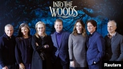 "Cast members and crew pose during a media event for the film ""Into the Woods,"" in London, Jan. 7, 2015."