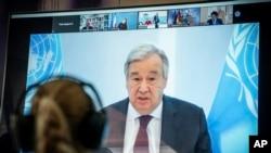 FILE - U.N. Secretary-General Antonio Guterres is seen speaking on a screen at the Environment Ministry, in Berlin, Germany, April 28, 2020.