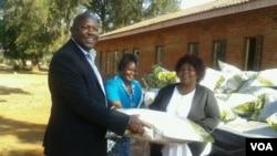 Okay Machisa presenting blankets and other goods at Northcot Training Institute. (Photo/Irwin Chifera)