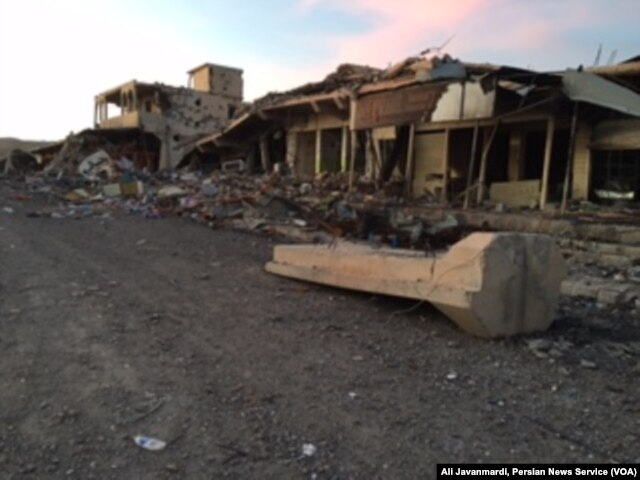 FILE - U.S. airstrikes damaged an Islamic State military base in the center of Sinjar.